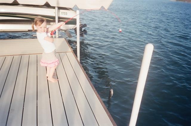 Maddie fishing with Boppa